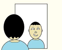 鏡で自分を見る男性